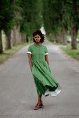 Model wearing green color classic dress with short sleeves, image from the front