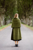 Woman wearing green color wool shawl, image from the back