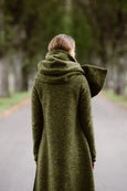 Woman wearing green color wool shawl, picture from the back