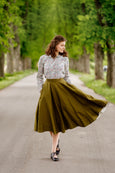 Women in linen floral shirt matched with linen skirt.
