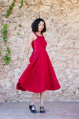 Red linen dress with straps, buttons on the side and flare skirt