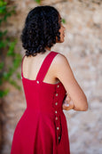 Picture of the back of the red linen dress: strap and button detail