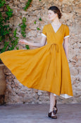 Marigold linen wrap dress with short sleeves and wide a-line skirt