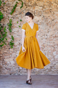 Linen wrap dress with white rolled up sleeves and flare skirt in solid yellow color