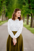 Woman in white linen shirt matched with linen skirt