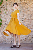 Linen wrap dress in marigold color with flare mid length skirt