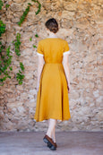 Mustard yellow linen dress with short sleeves and wide skirt with pockets