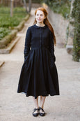 Woman wearing white linen midi skirt, image from the front