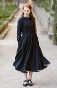 Woman wearing white linen midi skirt, picture from the front