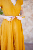 Up close detail of yellow wrap dress for women