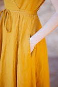 Up close detail of yellow wrap dress and it's pocket