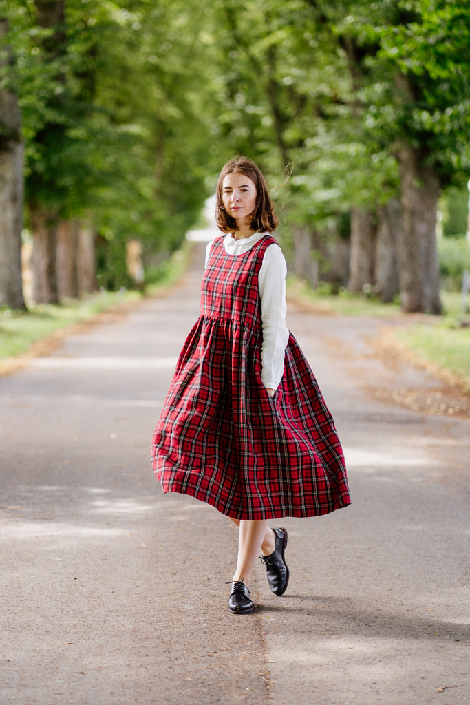 Red tartan loose fit sleeveless linen dress styled with white linen shirt