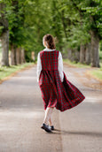 Woman pictured from the back in plaid linen sleeveless dress