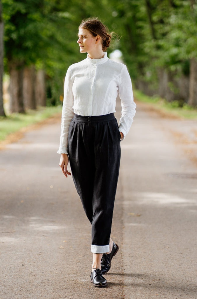 Woman wearing grey color long wool sweater, up close image from the front