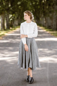 Woman wearing grey color twill midi skirt, image from the front