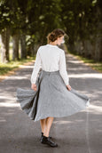 Woman wearing grey color twill midi skirt, image from the back