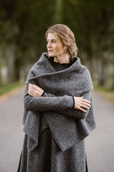 Woman wearing grey color wool shawl, picture from the front