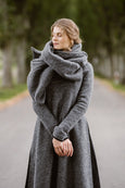Woman wearing grey color wool shawl, image from the front