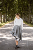 Woman wearing grey color twill midi skirt, picture from the front