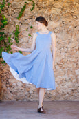 Light blue linen dress with straps and flare a-line skirt