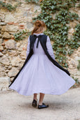 Woman wearing black linen flattering apron, image from the back