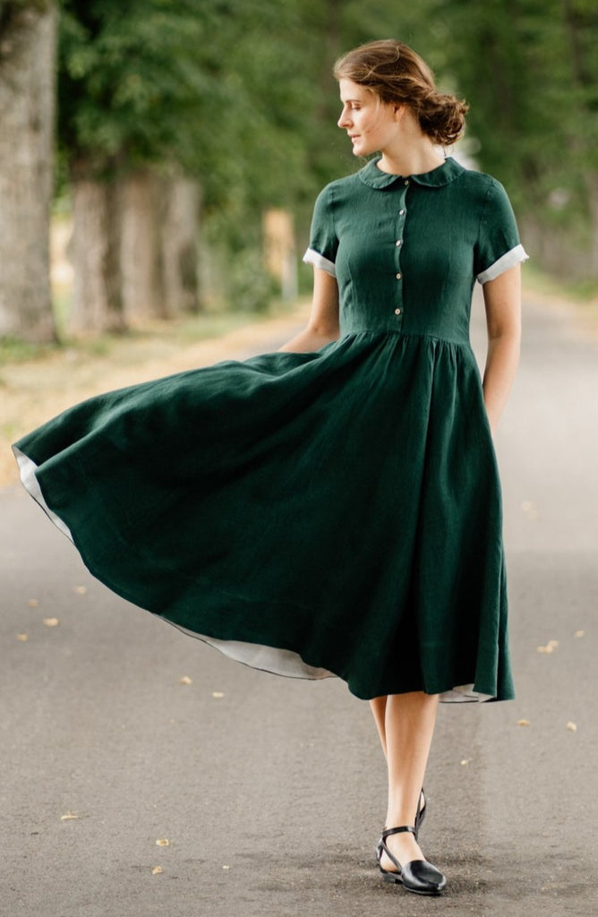 Woman in 1950's style linen dress in evergreen color