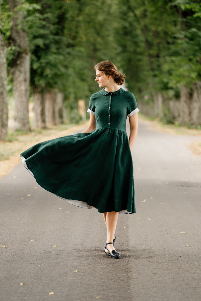 Model in linen 1950's style dress with short sleeves