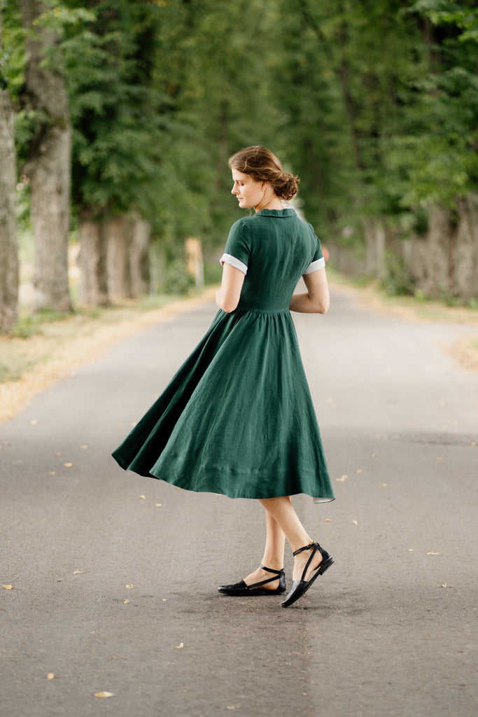 Woman in linen midi dress, pictured from the side