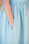 The pocket detail on linen dress in mint green color
