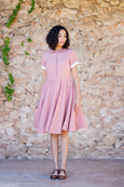 Simple classic linen dress for woman with flare skirt, pockets, short rolled up sleeves and front button detail