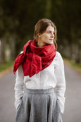 Model wearing red shawl, image from the front.