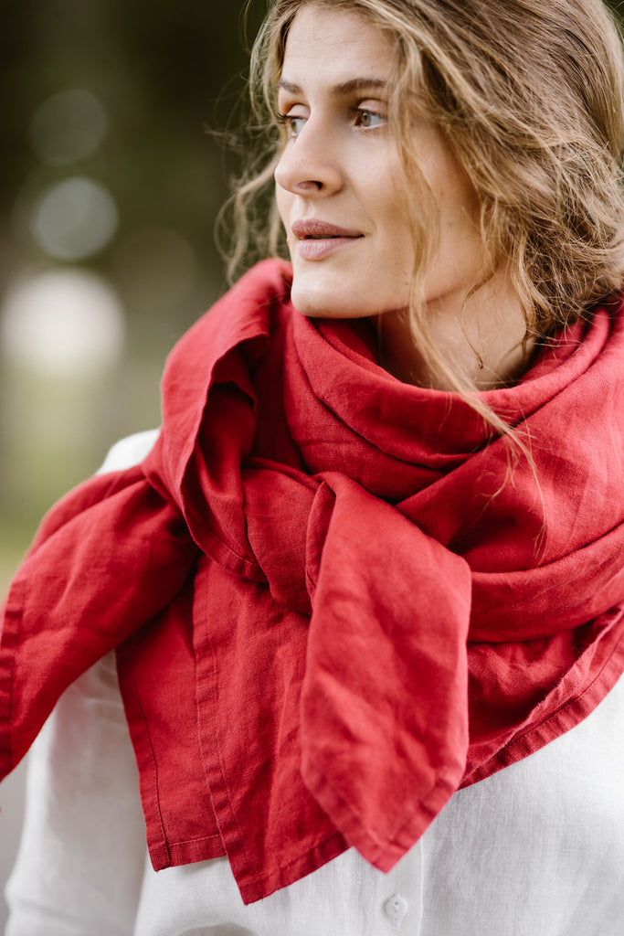 Woman wearing red shawl, up-close picture from the front.