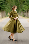 Woman wearing blue color classic dress with short sleeves, up close image from the front