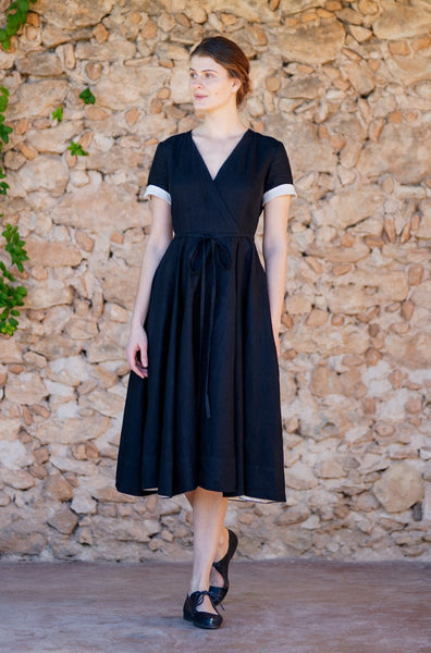 Minimalist black wrap linen dress with flare skirt and short sleeves