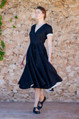Black wrap dress with short sleeves and full a-line skirt with pockets