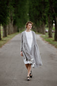 Woman wearing grey color wrap dress with long sleeves, picture from the front