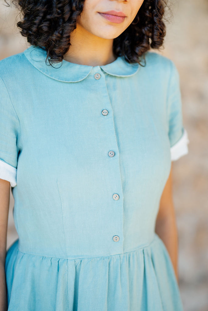 Button details on a green linen dress for women