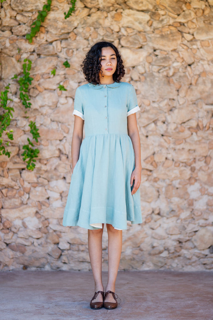 Short classic dress in light green color and linen material