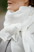 Model wearing white color shawl, up-close image from the side.