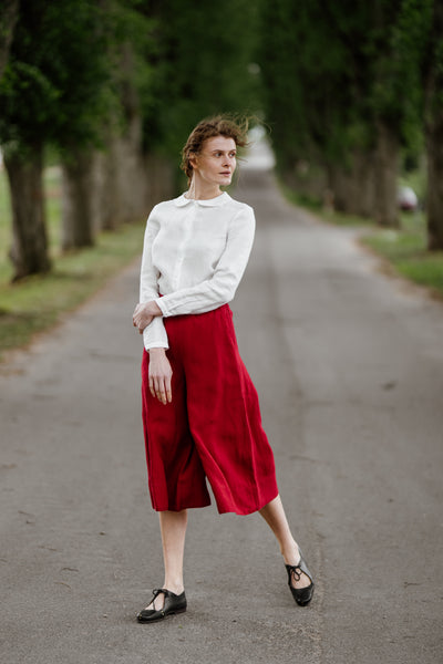 Woman wearing red color linen trousers, image from the front