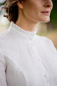 White linen collared shirt, up close image of a ruffle collar