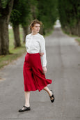 Model wearing red color linen trousers, image from the front