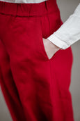 Woman wearing red color linen trousers, up close image of a pocket