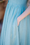up close picture of green mint linen dress and it's pocket