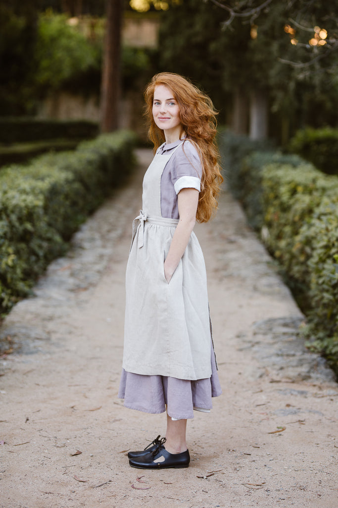 Woman wearing natural linen apron, image from the side