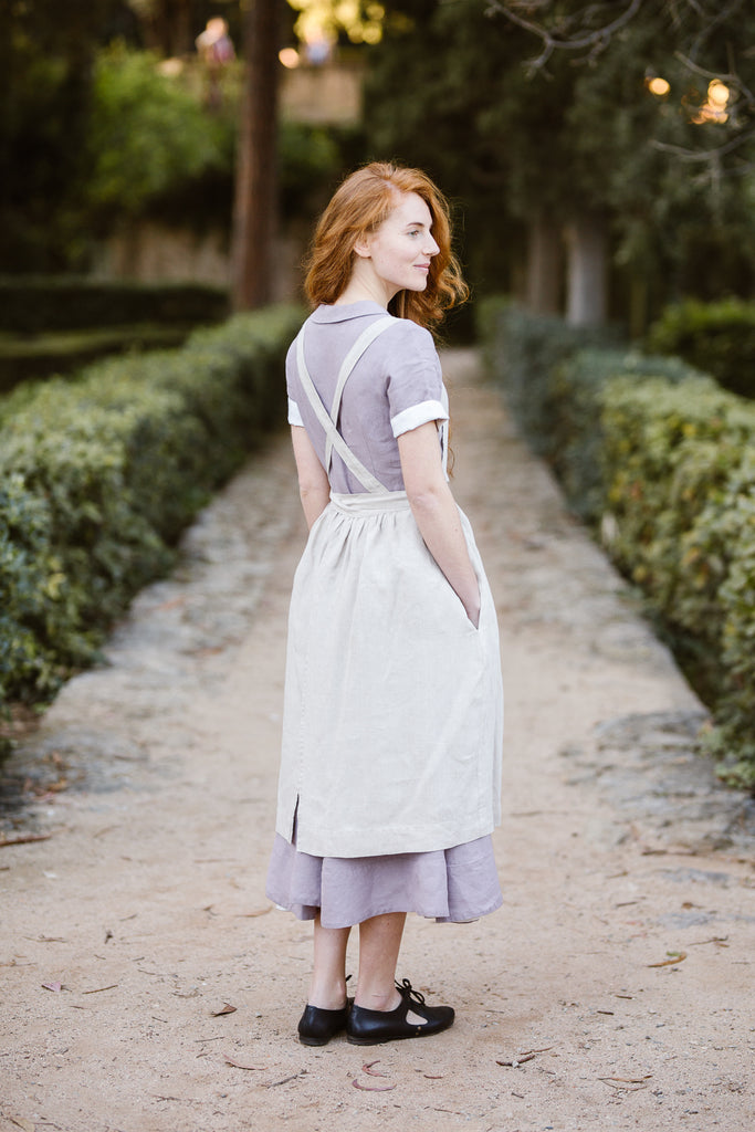 Woman wearing natural linen apron, image from the back