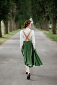 Model wearing beige color linen suspenders with adjustable clip-end, picture from the back.