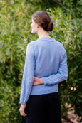 Long sleeved linen shirt in light blue color for women