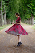 Model in linen tartan pattern dress with full skirt and short sleeves
