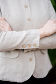Up close detail of linen jacket in natural color